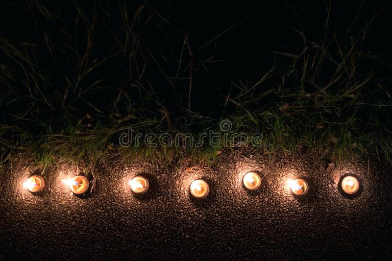 What Time Is Candle Lighting Burning Candles In Style Light Row At Night